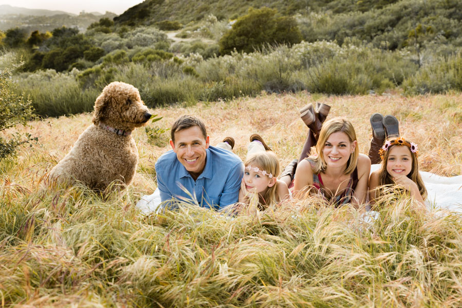 family with dog in fields