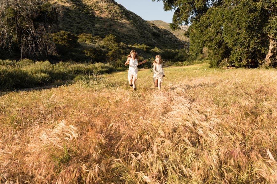 girls running through field