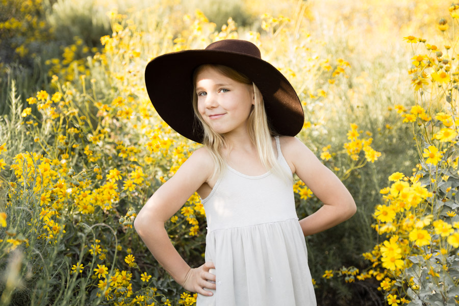 girl in hat in wildflowers