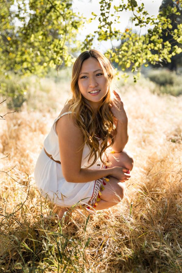 girl in the field golden hour
