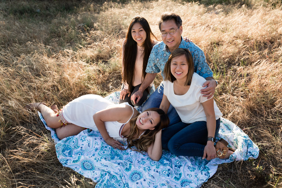 dad and the girls on a blanket