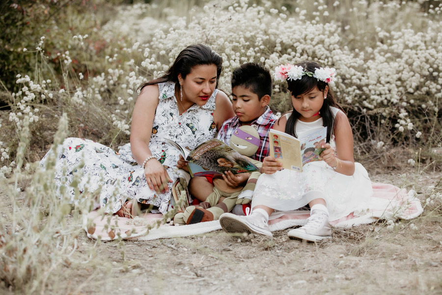 mother and children reading book