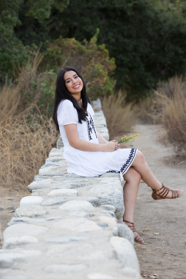 girl on stone wall